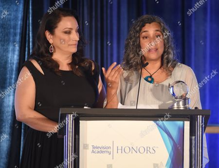 Stock Image of Co-directors Trish Adlesic, left, and Geeta Gandbhir accept the Television Academy Honors award for 'I Am Evidence'