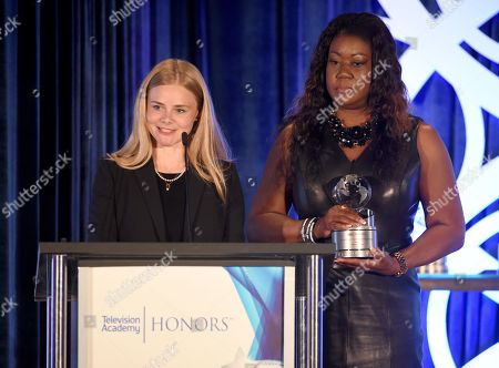 """Julia Willoughby Nason, left, and Sybrina Fulton, mother of Trayvon Martin, accept the Television Academy Honors Award for """"Rest in Power: The Trayvon Martin Story"""" at the 12th Annual Television Academy Honors, Thursday, May 30, 2019, at the Beverly Wilshire Hotel in Los Angeles. (Photo by Phil Mccarten/Invision for the Television Academy/AP Images)"""