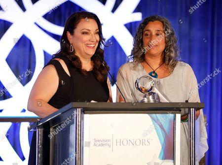 "Trish Adlesic, Geeta Gandbhir. Co-directors Trish Adlesic, left, and Geeta Gandbhir accept the Television Academy Honors Award for ""I Am Evidence"" at the 12th Annual Television Academy Honors, at the Beverly Wilshire Hotel in Los Angeles"