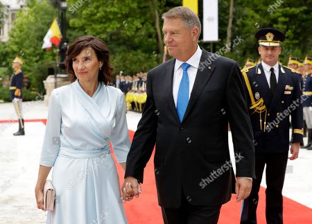 Romanian President Klaus Iohannis and his wife Carmen attend a welcome ceremony for Pope Francis in the gardens of the Cotroceni Presidential Palace, in Bucharest, Romania, . Francis arrived in Romania on Friday for a three-day, cross-country pilgrimage that in many ways is completing the 1999 trip by St. John Paul II that marked the first-ever papal visit to a majority Orthodox country