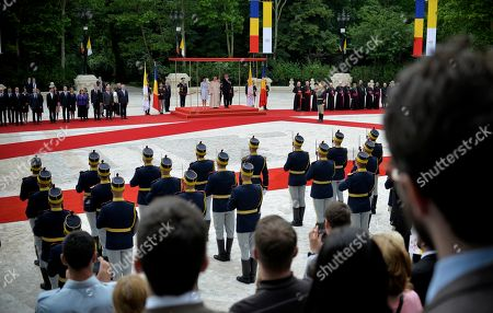 Pope Francis, center top, Romanian President Klaus Iohannis, and his wife Carmen attend a welcome ceremony at the gardens of the Cotroceni Presidential Palace, in Bucharest, Romania, .Francis arrived in Romania on Friday for a three-day, cross-country pilgrimage that in many ways is completing the 1999 trip by St. John Paul II that marked the first-ever papal visit to a majority Orthodox country