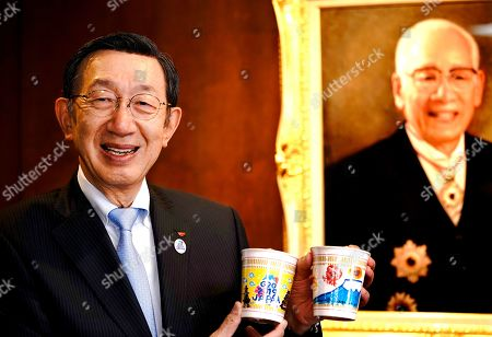 In this image released, Nissin Foods Holdings Co. President Koki Ando poses for a photo during an interview at Nissin Foods headquarters at Tokyo. On August 25, 1958, Momofuku Ando invented the world's first instant noodles in his backyard in Ikeda