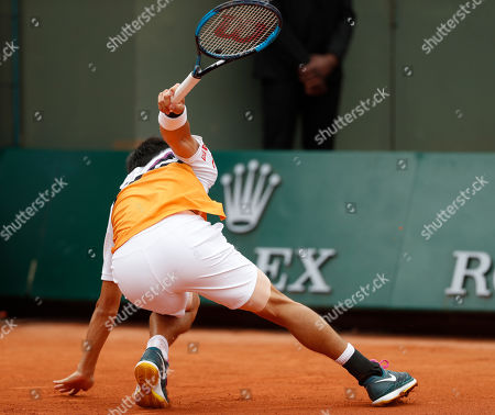 Japan's Kei Nishikori slips during his third round match of the French Open tennis tournament against Serbia's Laslo Djere at the Roland Garros stadium in Paris