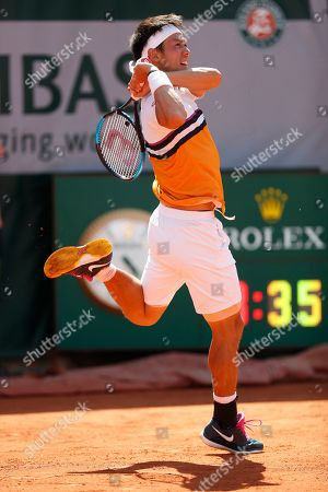 Japan's Kei Nishikori plays a shot against Serbia's Laslo Djere during their third round match of the French Open tennis tournament at the Roland Garros stadium in Paris