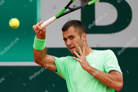 Serbia's Laslo Djere plays a shot against Japan's Kei Nishikori during their third round match of the French Open tennis tournament at the Roland Garros stadium in Paris