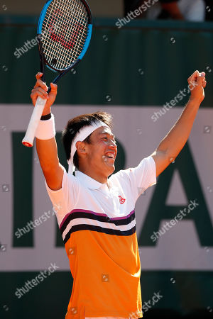 Japan's Kei Nishikori celebrates winning his third round match of the French Open tennis tournament against Serbia's Laslo Djere in five sets, 6-4, 6-7 (6-8), 6-3, 4-6, 8-6, at the Roland Garros stadium in Paris