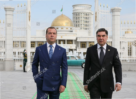 Russian Prime Minister Dmitry Medvedev (L) and Turkmenistan President Gurbanguly Berdymukhamedov (R) arrive for a meeting of the Council of the Commonwealth of Independent States (CIS) Government Heads in Ashgabat, Turkmenistan, 31 May 2019.