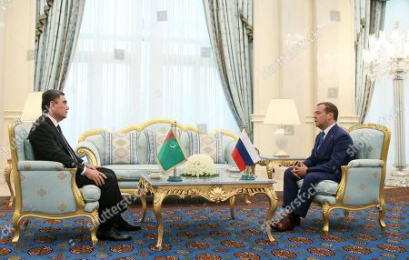 Russian Prime Minister Dmitry Medvedev (R) meets with Turkmenistan President Gurbanguly Berdymukhamedov (L) on the sidelines of a meeting of the Commonwealth of Independent States (CIS) Council of Government Heads in Ashgabat, Turkmenistan, 31 May 2019.