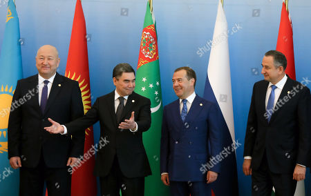 (L-R) Kyrgyzstan's Deputy Prime Minister Zhenish Razakov, Turkmenistan's  President Gurbanguly Berdymukhamedov, Russian Prime Minister Dmitry Medvedev and Tajikistan's First Deputy Prime Minister Davlatali Saidov posefor a picture ahead of a meeting of the Commonwealth of Independent States (CIS) Council of Government Heads in Ashgabat, Turkmenistan, 31 May 2019.