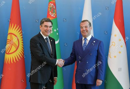 Russian Prime Minister Dmitry Medvedev (R) shakes hands with Turkmenistan President Gurbanguly Berdymukhamedov (L) before a meeting of the Commonwealth of Independent States (CIS) Council of Government Heads in Ashgabat, Turkmenistan, 31 May 2019.