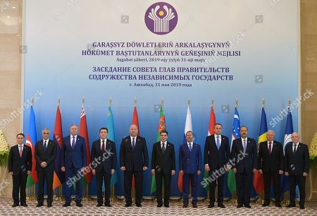(L-R) Azerbaijan's Prime Minister Novruz Mammadov, Armenian Deputy Prime Minister Mher Grigoryan, Belarusian Prime Minister Sergei Rumas, Kazakhstan's Prime Minister Askar Mamin, Kyrgyzstan's Deputy Prime Minister Zhenish Razakov, Turkmenistan's President Gurbanguly Berdymukhamedov, Russian Prime Minister Dmitry Medvedev, Tajikistan's First Deputy Prime Minister Davlatali Saidov, Uzbekistan's Prime Minister Abdulla Aripov, Moldovan Representative at the CIS institutions Victor Sorochan and CIS Executive Secretary Sergei Lebedev pose for a picture ahead of a meeting of the Commonwealth of Independent States (CIS) Council of Government Heads in Ashgabat, Turkmenistan, 31 May 2019.