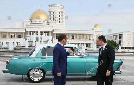 Russian Prime Minister Dmitry Medvedev (L) speaks with Turkmenistan President Gurbanguly Berdymukhamedov (R) as they arrive in a GAZ-21 Volga car for a meeting of the Commonwealth of Independent States (CIS) Council of Government Heads in Ashgabat, Turkmenistan, 31 May 2019.