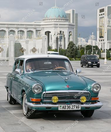 Russian Prime Minister Dmitry Medvedev (L) speaks with Turkmenistan President Gurbanguly Berdymukhamedov (R) inside a GAZ-21 Volga car as they arrive for a meeting of the Commonwealth of Independent States (CIS) Council of Government Heads in Ashgabat, Turkmenistan, 31 May 2019.