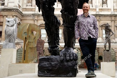 British artist Thomas Houseago poses for photographers during a photocall in the courtyard of the Royal Academy in Central London, Britain, 31 May 2019. Mr Houseago created an installation of six sculptures in the courtyard of the Royal Academy as part of the Summer Exhibition which runs from 10 June to 12 August 2019.