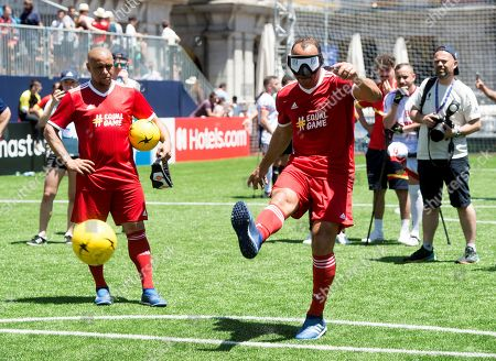 Former Brazilian soccer player Cafu kicks a penalty with the eyes covered as he takes part in an exhibition game with amputee players held at the at the Plaza Mayor on the occasion of the UEFA Champions League final, in Madrid, Spain, 31 May 2019. Liverpool and Tottenham will play the UEFA Champions League final at Wanda Metropolitano on the upcoming 01 June.