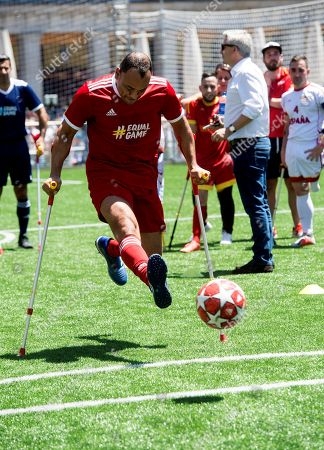Former Brazilian soccer player Cafu kicks a penalty using crutches as he takes part in an exhibition game with amputee players held at the at the Plaza Mayor on the occasion of the UEFA Champions League final, in Madrid, Spain, 31 May 2019. Liverpool and Tottenham will play the UEFA Champions League final at Wanda Metropolitano on the upcoming 01 June.