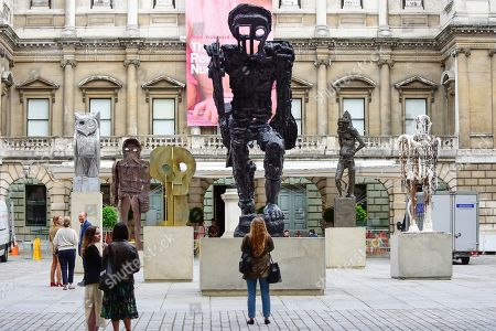 Stock Picture of People view a major installation of six recent sculptures by celebrated artist Thomas Houseago is unveiled in the courtyard of the Royal Academy of Arts in Piccadilly.  The installation forms part of The Summer Exhibition which runs 10 June to 12 August 2019.
