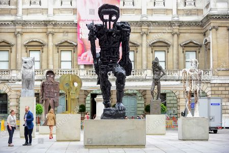 Stock Photo of A major installation of six recent sculptures by celebrated artist Thomas Houseago is unveiled in the courtyard of the Royal Academy of Arts in Piccadilly.  The installation forms part of The Summer Exhibition which runs 10 June to 12 August 2019.