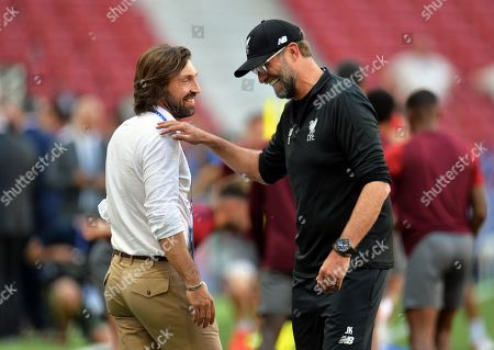 Liverpool's manager Jurgen Klopp (R) is greeted by former Italian player Andrea Pirlo (L) during his team's training session at the Wanda Metropolitano stadium in Madrid, Spain, 31 May 2019. Liverpool FC will face Tottenham Hotspur in the 2019 UEFA Champions League final at the Wanda Metropolitano stadium in Madrid, Spain, on 01 June 2019.