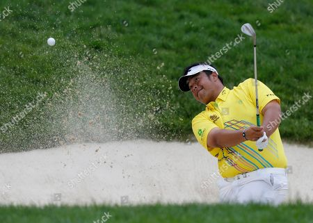 Kiradech Aphibarnrat, of Thailand, hits from the sand on the 18th hole during the second round of the Memorial golf tournament, in Dublin, Ohio
