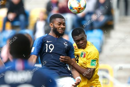 France's Moussa Sylla, left, and Mali's Fode Konate challenge for the ball during the Group E U20 World Cup soccer match between Mali and France, in Gdynia, Poland