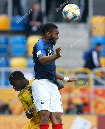 Mali's Fode Konate, left, and France's Moussa Sylla challenge for the ball during the Group E U20 World Cup soccer match between Mali and France, in Gdynia, Poland