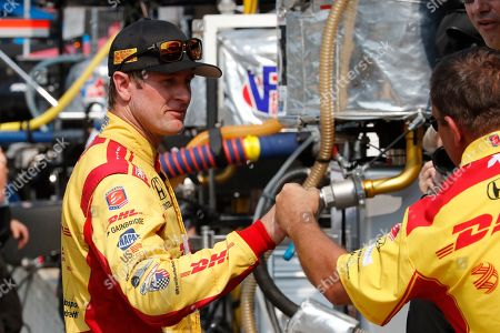 Ryan Hunter-Reay fist-bumps a crew member after a practice session for the first race of the IndyCar Detroit Grand Prix auto racing doubleheader, in Detroit