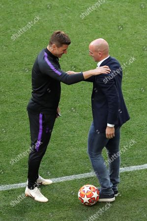 Tottenham head coach Mauricio Pochettino (L) is greeted by Argentinian former player Esteban Cambiasso (R) during a team's training session at the Wanda Metropolitano stadium in Madrid, Spain, 31 May 2019. Tottenham Hotspur will face Liverpool FC in the 2019 UEFA Champions League final at the Wanda Metropolitano stadium in Madrid, Spain, on 01 June 2019.