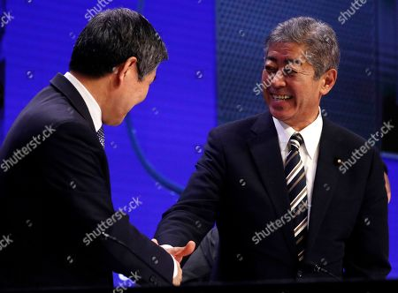 South Korean Minister of National Defence Jeong Kyeong-doo (L) and Japanese Minister for Defence Takeshi Iwaya (R) shake hands during the second plenary session of the International Institute for Strategic Studies (IISS) 18th Asia Security Summit in Singapore, 01 June 2019. The IISS Asia Security Summit is an annual gathering of defense officials in the Asia-Pacific region and is dubbed the Shangri-La Dialogue in honor of the hotel where the event is held. The summit will be held from 31 May to 02 June 2019.
