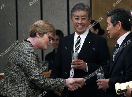 Japanese Minister for Defence Takeshi Iwaya (C) looks on as Australian Defence Minister Linda Reynolds (L) shakes hands with South Korean Minister of National Defence Jeong Kyeong-doo (R) during a ministerial roundtable on the sidelines of the International Institute for Strategic Studies (IISS) 18th Asia Security Summit in Singapore, 01 June 2019. The IISS Asia Security Summit is an annual gathering of defense officials in the Asia-Pacific region and is dubbed the Shangri-La Dialogue in honor of the hotel where the event is held. The summit will be held from 31 May to 02 June 2019.