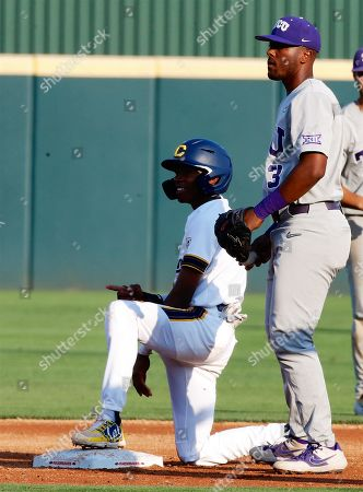 Stock Image of California base runner Darren Baker #2 points to the dugout following him stealing second base. .TCU defeated California 13-2 in Fayetteville, AR, Richey Miller/CSM