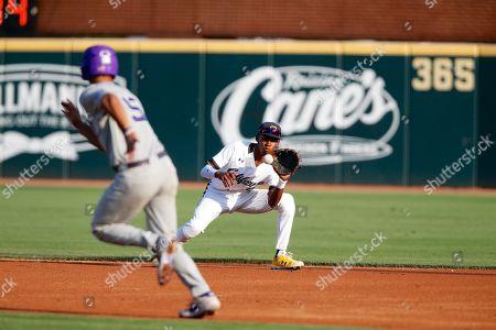 Darren Baker #2 California second baseman fields a ball that is hit towards him. TCU defeated California 13-2 in Fayetteville, AR, Richey Miller/CSM