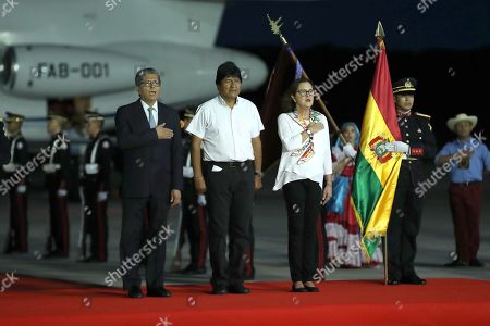 Salvadoran Deputy Foreign Minister Jaime Miranda (L) and the incoming Foreign Minister of El Salvador Alexandra Hill Tinoco (R) receive the President of Bolivia Evo Morales (C) upon his arrival to San Luis Talpa, El Salvador, 31 May 2019. Varela visits El Salvador to attend on 01 June the inauguration on Salvadoran elected president Nayib Bukele.