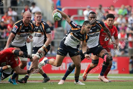 Brumbies' Tom Wright, center, carries the ball during the second half of a Super Rugby game against the Sunwolves, in Tokyo