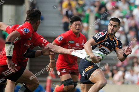Mark Abbott, Tom Wright. Sunwolves' Mark Abbott, left, grabs the jersey of Brumbies' Tom Wright during the second half of a Super Rugby game, in Tokyo