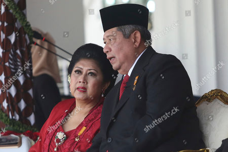 In this Aug. 17, 2014, photo, then Indonesian first lady Kristiani, left, talks to her husband President Susilo Bambang Yudhoyono during a ceremony commemorating the country's independence day. Kristiani, the wife of Indonesia's sixth President Susilo Bambang Yudhoyono, has died, in Singapore where she had been treated for cancer for several months. She was 66