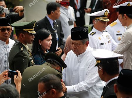 Former Indonesian President Susilo Bambang Yudhoyono (C-R)  is greeted by military personnel at the Indonesian embassy building in Singapore, 01 June 2019. The wife of former Indonesian President Susilo Bambang Yudhoyono passed away on 01 June 2019 aged 66 at the National University Hospital after losing her battle with blood cancer.