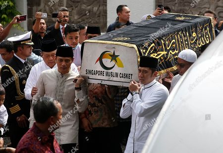 Former Indonesian President Susilo Bambang Yudhoyono (2-L) accompanies his sons Agus Harimurti Yudhoyono (3-L) and Edhie Baskoro Yudhoyono (2-R) as they carry a casket containing the body of former Indonesian First Lady Ani Yudhoyono at the Indonesian embassy building in Singapore, 01 June 2019. The wife of former Indonesian President Susilo Bambang Yudhoyono passed away on 01 June 2019 aged 66 at the National University Hospital after losing her battle with blood cancer.