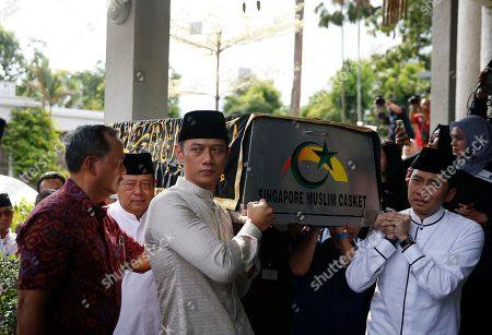 Former Indonesian President Susilo Bambang Yudhoyono (2-L), his sons Agus Harimurti Yudhoyono (C), and Edhie Baskoro Yudhoyono (R) are seen carrying a casket containing the body of former Indonesian First Lady Ani Yudhoyono at the Indonesian embassy building in Singapore, 01 June 2019. The wife of former Indonesian President Susilo Bambang Yudhoyono passed away on 01 June 2019 aged 66 at the National University Hospital after losing her battle with blood cancer.