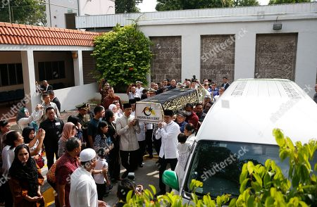 An crowd surrounds the casket containing the body of former Indonesian First Lady Ani Yudhoyono at the Indonesian embassy building in Singapore, 01 June 2019. The wife of former Indonesian President Susilo Bambang Yudhoyono passed away on 01 June 2019 aged 66 at the National University Hospital after losing her battle with blood cancer.