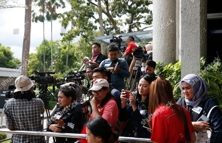 Members of the media gather to await the arrival of the casket containing the body of former Indonesian First Lady Ani Yudhoyono at the Indonesian embassy building in Singapore, 01 June 2019. The wife of former Indonesian President Susilo Bambang Yudhoyono passed away on 01 June 2019 aged 66 at the National University Hospital after losing her battle with blood cancer.