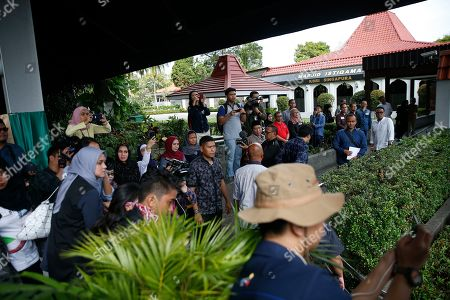Spectators and members of the media look on as a casket containing the body of former Indonesian First Lady Ani Yudhoyono arrives at the Indonesian embassy building in Singapore, 01 June 2019. The wife of former Indonesian President Susilo Bambang Yudhoyono passed away on 01 June 2019 aged 66 at the National University Hospital after losing her battle with blood cancer.