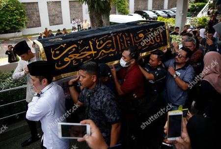 Pallbearers led by Agus Harimurti Yudhoyono (back-L) and Edhie Baskoro Yudhoyonoby (2-L) carry a casket containing the body of former Indonesian First Lady Ani Yudhoyono through the Indonesian embassy building in Singapore, 01 June 2019. The wife of former Indonesian President Susilo Bambang Yudhoyono passed away on 01 June 2019 aged 66 at the National University Hospital after losing her battle with blood cancer.