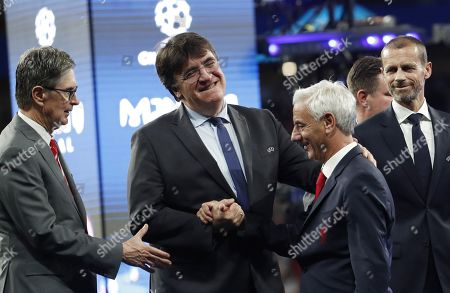 Liverpool owner John Henry (L), UEFA Secretary General Theodore Theodoridis  (2L) congratulate Liverpool legend Ian Rush in front of UEFA president Aleksander Ceferin (R) after the UEFA Champions League final between Tottenham Hotspur and Liverpool FC at the Wanda Metropolitano stadium in Madrid, Spain, 01 June 2019. Liverpool won 2-0.