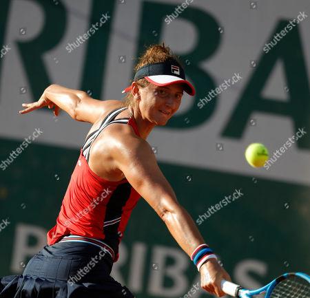 Stock Photo of Romania's Irina-Camelia Begu plays a shot against Amanda Anisimova of the U.S. during their third round match of the French Open tennis tournament at the Roland Garros stadium in Paris