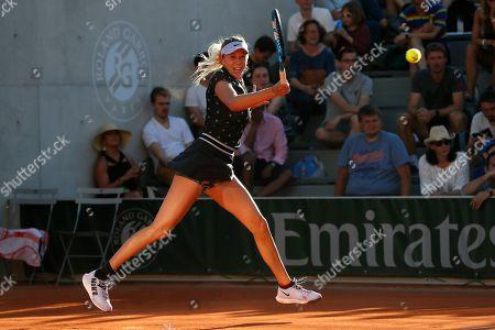 Amanda Anisimova of the U.S. plays a shot against Romania's Irina-Camelia Begu during their third round match of the French Open tennis tournament at the Roland Garros stadium in Paris