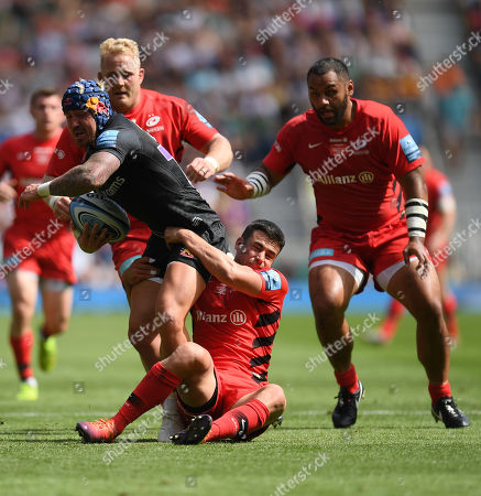 Jack Nowell of Exeter Chiefs is tackled by Alex Goode of Saracens