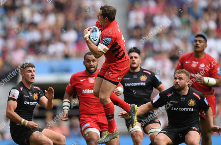 Alex Goode of Saracens gathers up the loose ball