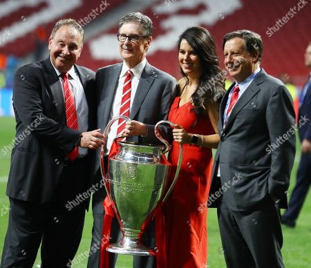 Liverpool owner John W Henry and his wife Linda Pizzuti celebrates at the end with the trophy