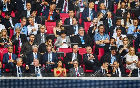 Liverpool Owner John W.Henry front row with his wife and Edwin van der Sar, Antonio Conte (left), kaka, amongst others